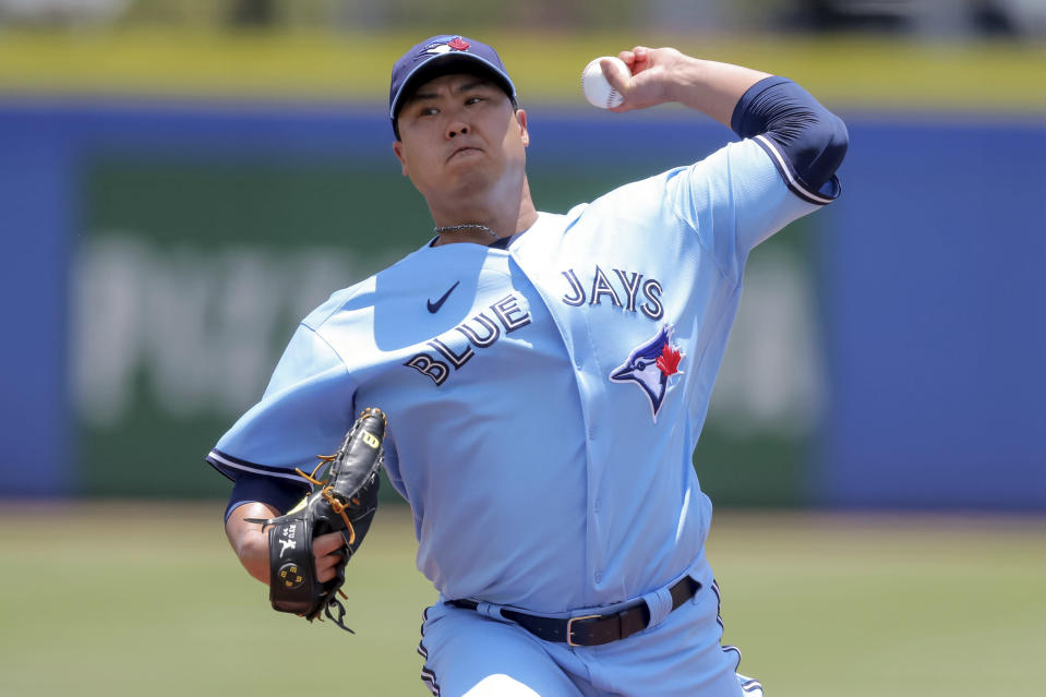 Toronto Blue Jays starting pitcher Hyun Jin Ryu throws against the Tampa Bay Rays during the first inning of a baseball game Sunday, May 23, 2021, in Dunedin, Fla. (AP Photo/Mike Carlson)