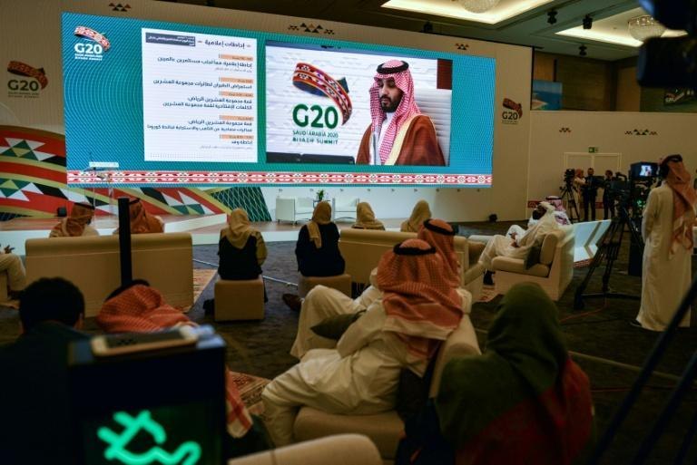 Journalists at the International Media Centre in Riyadh watch on a projected screen as Saudi Crown Prince Mohammed bin Salman attends the G20 summit, held virtually due to the coronavirus pandemic
