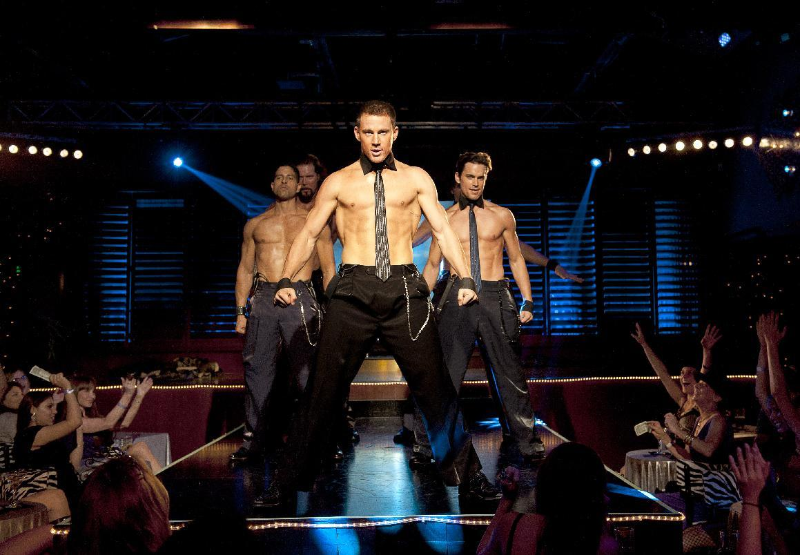 "FILE - This file photo released by Warner Bros. shows, from left, Adam Rodriguez, Kevin Nash, Channing Tatum, and Matt Bomer in a scene from ""Magic Mike."" Matthew McConaughey, Channing Tatum, Alex Pettyfer, Joe Manganiello and Matt Bomer play firemen, cops and other exaggerated versions of hyper-masculine characters in the Steven Soderbergh film, and they say preparing for their parts and performing nearly nude for the dozens of female extras who populated the fake Club Xquisite gave the actors insight into women's grooming, undergarments and approach to carnal fantasy. (AP Photo/Warner Bros., Claudette Barius, File)"