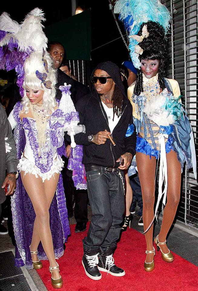 """After spending eight months behind bars, Lil Wayne was released from prison on Thursday ... and was ready to celebrate in Miami on Sunday night! Despite arriving at his """"Welcome Home, Tunechi"""" party on the arms of two rather scary looking wannabe Vegas showgirls, the rapper happily told MTV, """"I just wanna thank everybody. Not only MTV fans, but the fans across the whole world. Most of all, my family. I couldn't do it without them and I would never do it without them."""" John Parra/<a href=""""http://www.wireimage.com"""" target=""""new"""">WireImage.com</a> - November 7, 2010"""
