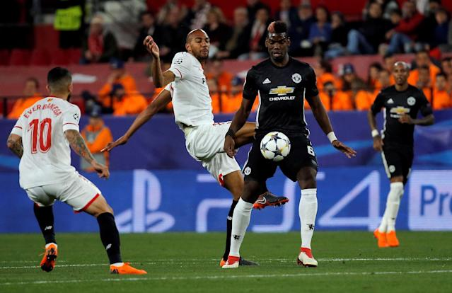 Soccer Football - Champions League Round of 16 First Leg - Sevilla vs Manchester United - Ramon Sanchez Pizjuan, Seville, Spain - February 21, 2018 Sevilla's Steven N'Zonzi in action with Manchester United's Paul Pogba REUTERS/Jon Nazca