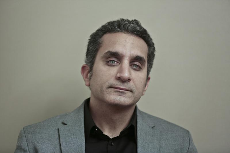 Egyptian satirist Bassem Youssef poses for a photograph at his studio in downtown Cairo, Egypt, Wednesday, Jan. 8, 2014. Youssef, often compared to U.S. comedian Jon Stewart, says his team will bring back its popular television show poking fun at politics in a country still beset by turmoil following a July military coup. However, he acknowledged the challenges facing him and others in Egypt now in an interview with The Associated Press. (AP Photo/Nariman El-Mofty)