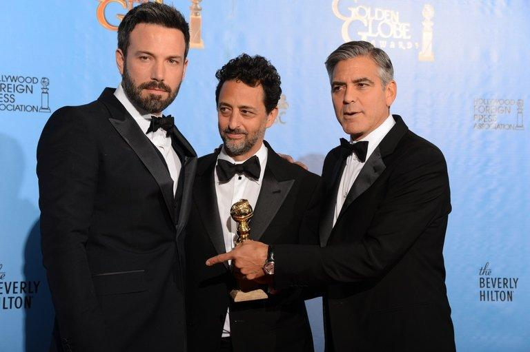 "(L-R) Actor-director Ben Affleck and producers Grant Heslov and George Clooney with the award for best motion picture drama for ""Argo"" at the Golden Globe awards on January 13, 2013. ""Argo"" won the top two Golden Globes last weekend and is nominated for seven prizes at next month's Academy Awards"