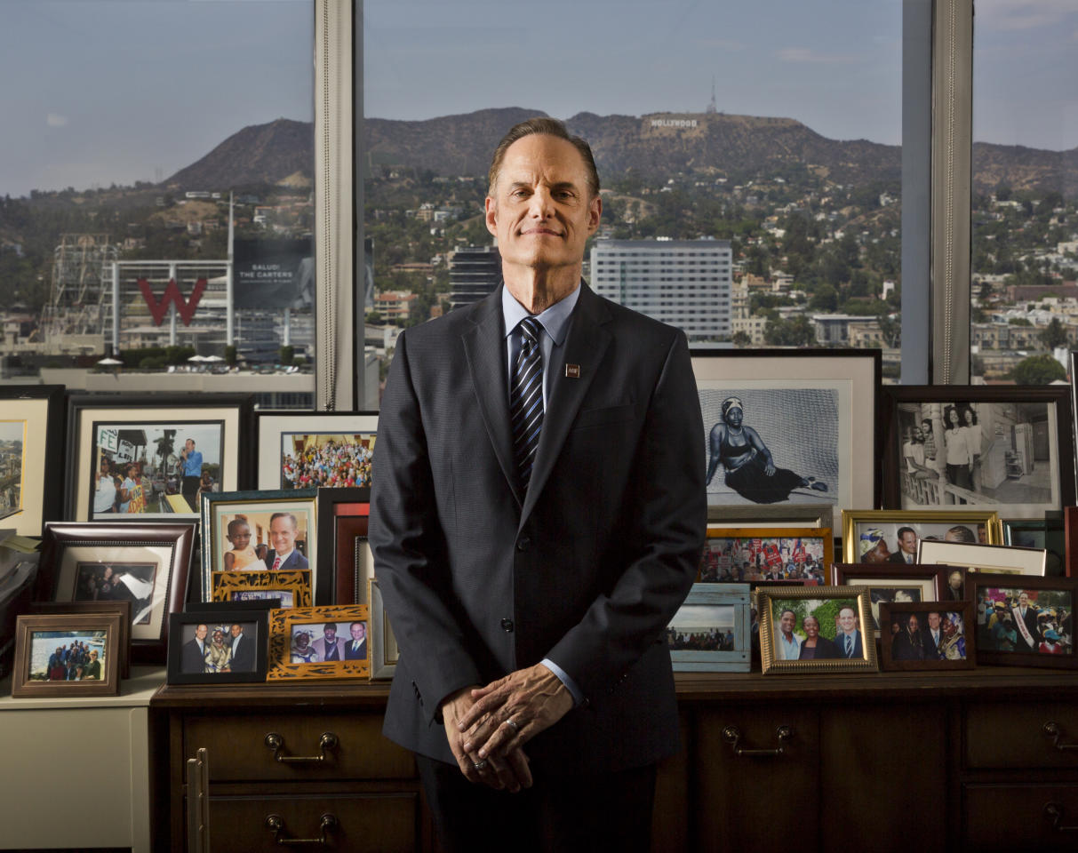 <p> In this Monday, July 30, 2018, photo Michael Weinstein, president of the AIDS Healthcare Foundation poses for a photo of his office overlooking the Hollywood Hills in Los Angeles. The AIDS Healthcare Foundation and Alliance of Californians for Community Empowerment Action are sponsoring a measure known as Proposition 10. The measure would let cities and counties regulate rental fees in buildings current state law shields from such control. (AP Photo/Damian Dovarganes) </p>