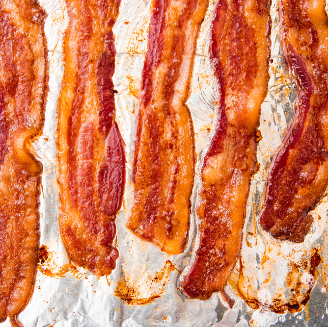 """<p>There are a lot of ways to cook <a href=""""https://www.delish.com/uk/cooking/recipes/a28995976/bacon-chips-recipe/"""" rel=""""nofollow noopener"""" target=""""_blank"""" data-ylk=""""slk:bacon"""" class=""""link rapid-noclick-resp"""">bacon</a>, but after lots of research (we've eaten A LOT of bacon, guys), we've determined the smartest to cook slices is in the oven: there's less mess, it makes serving bacon to a crowd SO easy, and the results are just as crispy.</p><p>Get the <a href=""""https://www.delish.com/uk/cooking/recipes/a30208165/how-to-cook-bacon-in-the-oven-recipe/"""" rel=""""nofollow noopener"""" target=""""_blank"""" data-ylk=""""slk:Oven-Baked Bacon"""" class=""""link rapid-noclick-resp"""">Oven-Baked Bacon</a> recipe.</p>"""