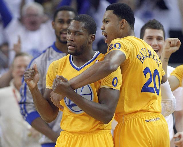 Golden State Warriors guard Toney Douglas (0) celebrates with guard Kent Bazemore (20) after making a three-point shot in the final seconds of the first half against the Los Angeles Clippers in an NBA basketball game, Wednesday, Dec. 25, 2013, in Oakland, Calif. (AP Photo/Tony Avelar)