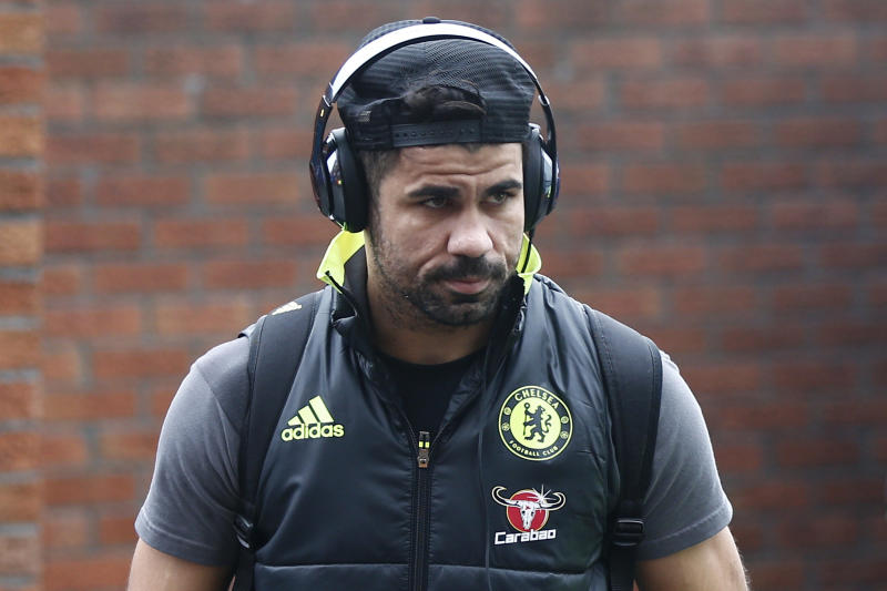 Chelsea's Diego Costa arrives before the game.