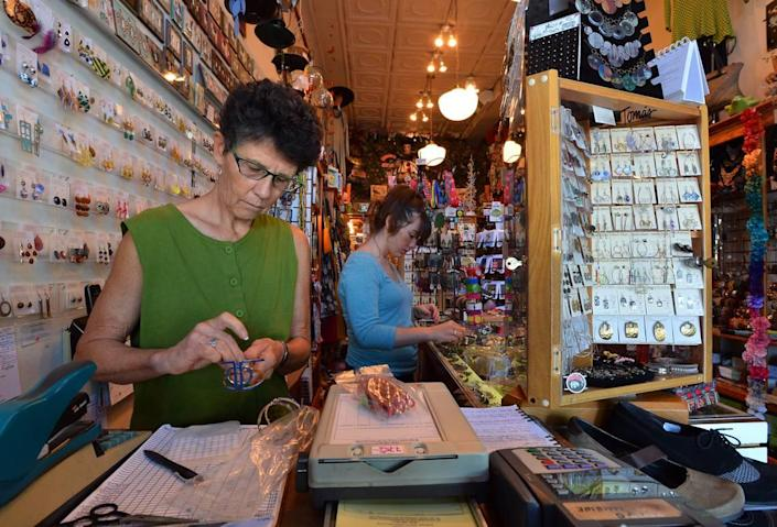 Carol Anderson, left, is owner of Vaguely Reminiscent, a clothing store on Ninth Street in Durham.