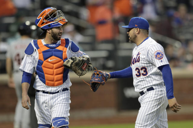 New York Mets catcher Tomas Nido, left, and relief pitcher Hector Santiago talk while heading to the dugout after the top of the 12th inning of a baseball game against the Detroit Tigers, Saturday, May 25, 2019, in New York. (AP Photo/Julio Cortez)