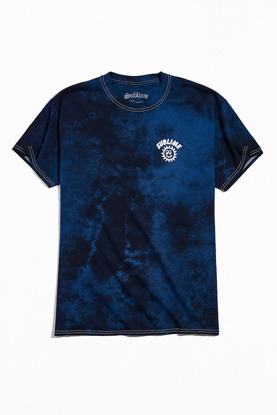 """<p><strong>Urban Outfitters</strong></p><p>urbanoutfitters.com</p><p><strong>$34.00</strong></p><p><a href=""""https://go.redirectingat.com?id=74968X1596630&url=https%3A%2F%2Fwww.urbanoutfitters.com%2Fshop%2Fsublime-lbc-crystal-wash-tee&sref=https%3A%2F%2Fwww.menshealth.com%2Fstyle%2Fg35864339%2Fbest-graphic-t-shirts-men%2F"""" rel=""""nofollow noopener"""" target=""""_blank"""" data-ylk=""""slk:BUY IT HERE"""" class=""""link rapid-noclick-resp"""">BUY IT HERE</a></p><p>Music graphic tees are a classic, and this is a great example of how to keep it feeling fresh. A small graphic on a dark tie-dye tee is the expert balance of old and new. </p>"""