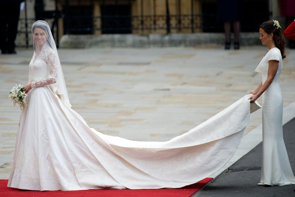 The Duchess of Cambridge, née Catherine Middleton, married Prince William in a delicate, lace Alexander McQueen dress in April 2011. (Getty Images)