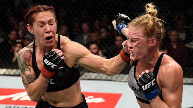 "Cris ""Cyborg"" Justino (L) got a true test from Holly Holm, but the featherweight champ prevailed in the end. (Getty)"