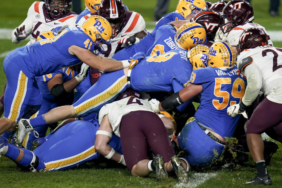 Pittsburgh quarterback Kenny Pickett (8) sneaks through the pile to score a touchdown against Virginia Tech during the second half of an NCAA college football game, Saturday, Nov. 21, 2020, in Pittsburgh. (AP Photo/Keith Srakocic)