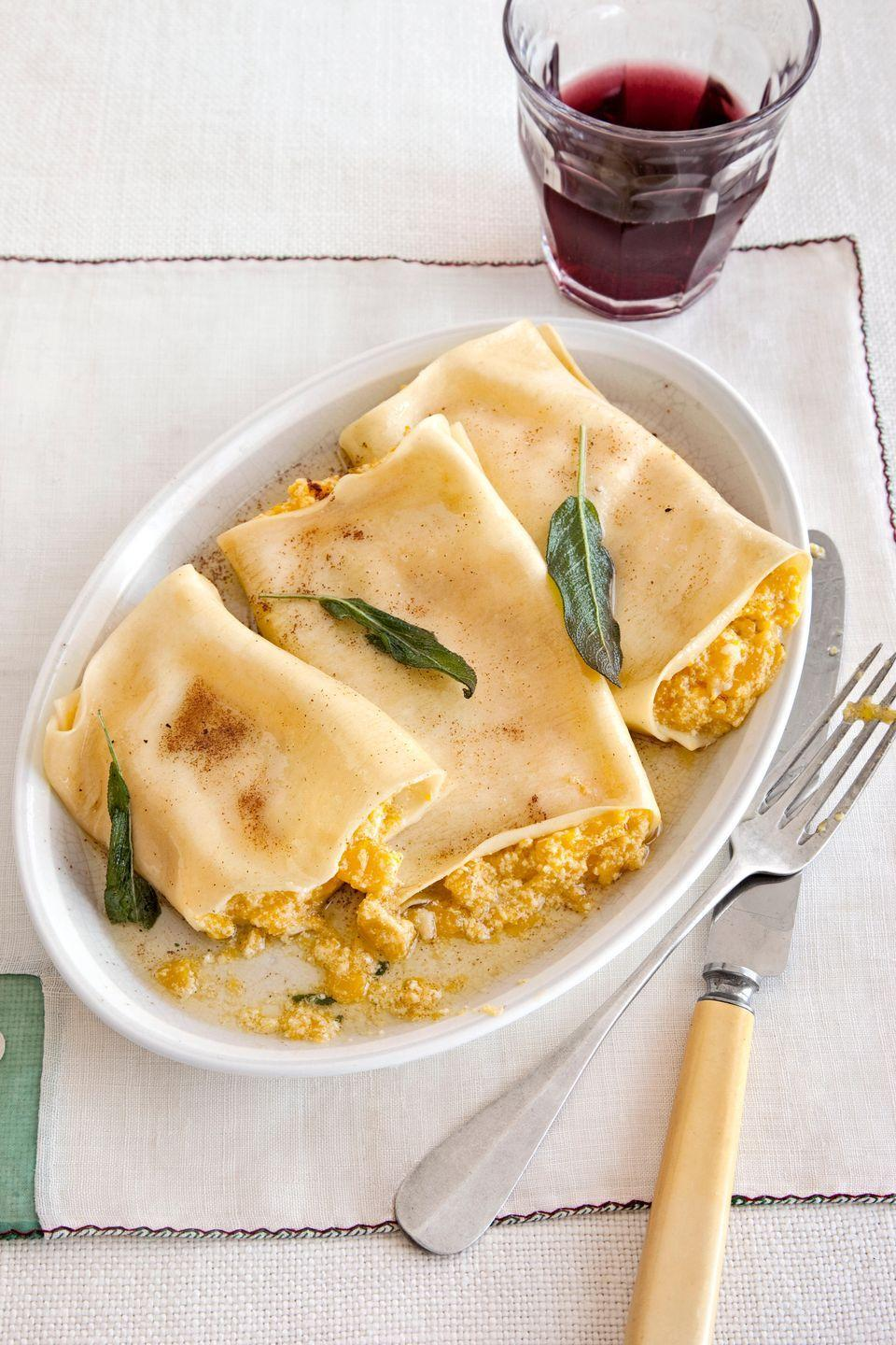 """<p>No need to make fresh pasta for these silky ricotta-pumpkin cannelloni—oven-ready lasagna sheets work just fine.</p><p><strong><a href=""""https://www.countryliving.com/food-drinks/recipes/a2995/pumpkin-cannelloni-sage-brown-butter-sauce-recipe/"""" rel=""""nofollow noopener"""" target=""""_blank"""" data-ylk=""""slk:Get the recipe"""" class=""""link rapid-noclick-resp"""">Get the recipe</a>.</strong><br></p><p><a class=""""link rapid-noclick-resp"""" href=""""https://www.amazon.com/Pyrex-Basics-Oblong-Baking-Plastic/dp/B01IUKIPYY?tag=syn-yahoo-20&ascsubtag=%5Bartid%7C10050.g.619%5Bsrc%7Cyahoo-us"""" rel=""""nofollow noopener"""" target=""""_blank"""" data-ylk=""""slk:SHOP BAKING DISHES"""">SHOP BAKING DISHES</a></p>"""