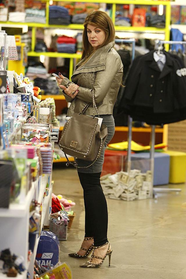"""It's been more than six months since Kirstie Alley was voted off """"Dancing With the Stars,"""" but she's still got her slim body and showed it off in some leggings while shopping at Los Angeles' Kitson boutique on Monday. (12/5/2011)"""