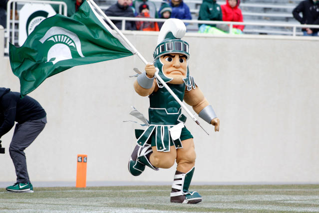 Michigan State mascot, Sparty, runs onto the field during an NCAA college football spring scrimmage, Saturday, April 7, 2018, in East Lansing, Mich. (AP Photo/Al Goldis)