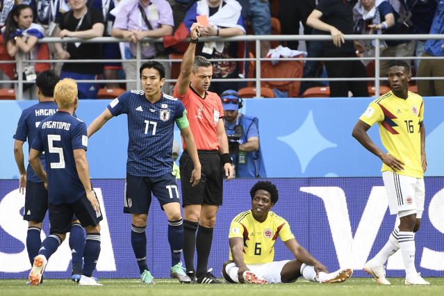 Carlos Sanchez is shown a red card during Colombia's Group Stage clash with Japan. (Getty)