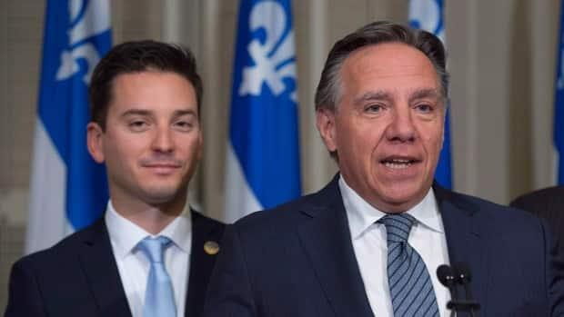 Quebec Justice Minister Simon Jolin-Barrette, left, and Premier François Legault shown two years ago. The provincial government intends to appeal Tuesday's Quebec Superior Court decision on Bill 21, unhappy with the exemptions granted.
