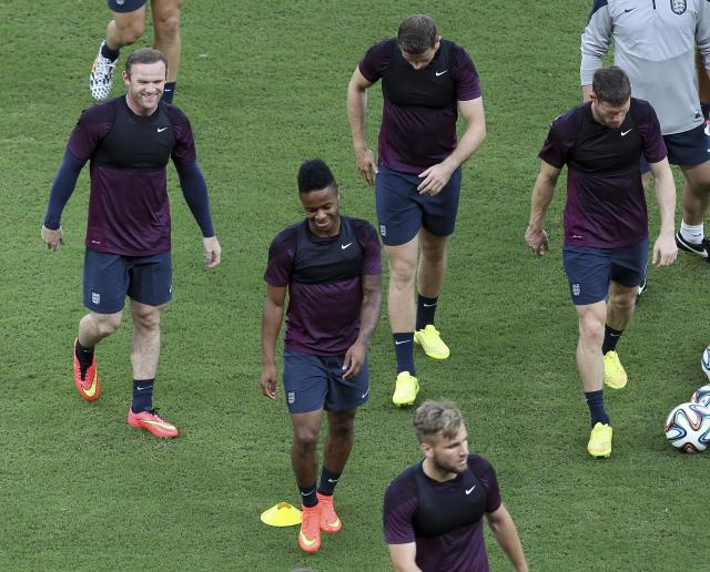 England players including Wayne Rooney, top left, and Raheem Sterling, second from left, smile during a training session at Arena da Amazonia in Manaus, Brazil, Friday, June 13, 2014. England plays in group D of the 2014 soccer World Cup. (AP Photo/Martin Mejia)