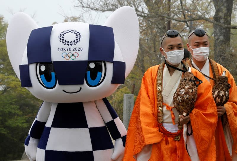 Unveiling of a display of Olympic symbol on Mt. Takao in Hachioji