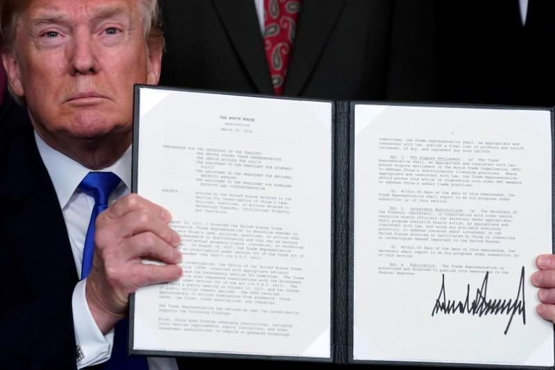 Trump slaps tariffs on $50 billion worth of Chinese technology goods