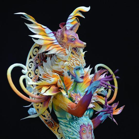 <p><b>The Big, Bad, Colorful Wolf</b></p><p>A closer look at fire battling water in this amazingly vibrant design by Italian artist Benedetta Carugati. (Source: Didier Messens/Redferns via Getty Images)</p>
