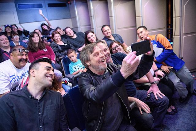 <p>Talk about a thrill ride! The original Luke Skywalker surprised guests on board the Star Tours attraction Tuesday at Disneyland in Anaheim, Calif. The same day, the park anounced that new elements inspired by the upcoming <em>Star Wars</em> film will debut Friday at Disneyland and Walt Disney World Resorts. (Photo: Richard Harbaugh/Disneyland via Getty Images) </p>