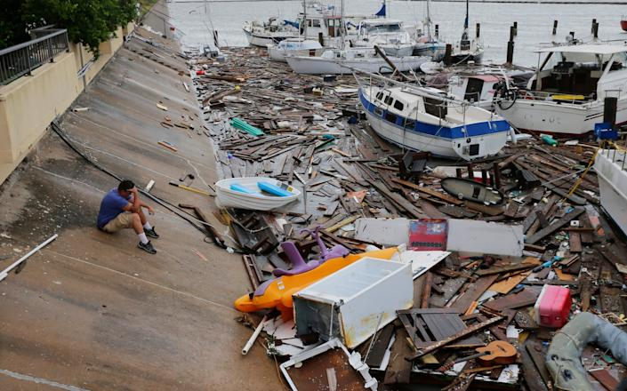 Allen Heath surveys the damage to a private marina in Corpus Christi, Texas after it was hit by Tropical Storm Hanna, which was downgraded from a hurricane as it hit land: AP