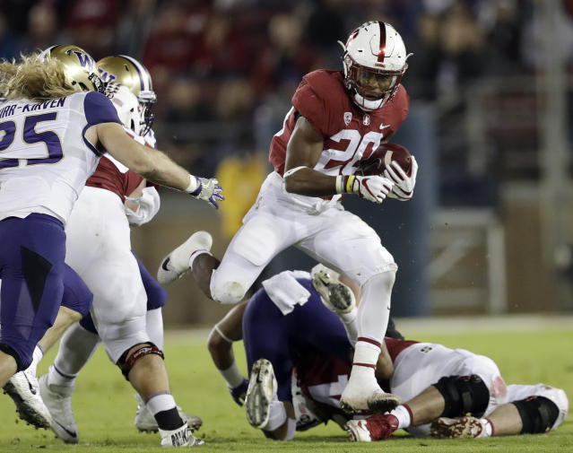 "Stanford RB <a class=""link rapid-noclick-resp"" href=""/ncaaf/players/257525/"" data-ylk=""slk:Bryce Love"">Bryce Love</a> (20) is 20 yards shy of reaching 2,000 yards rushing for the season. (AP Photo/Marcio Jose Sanchez, File)"