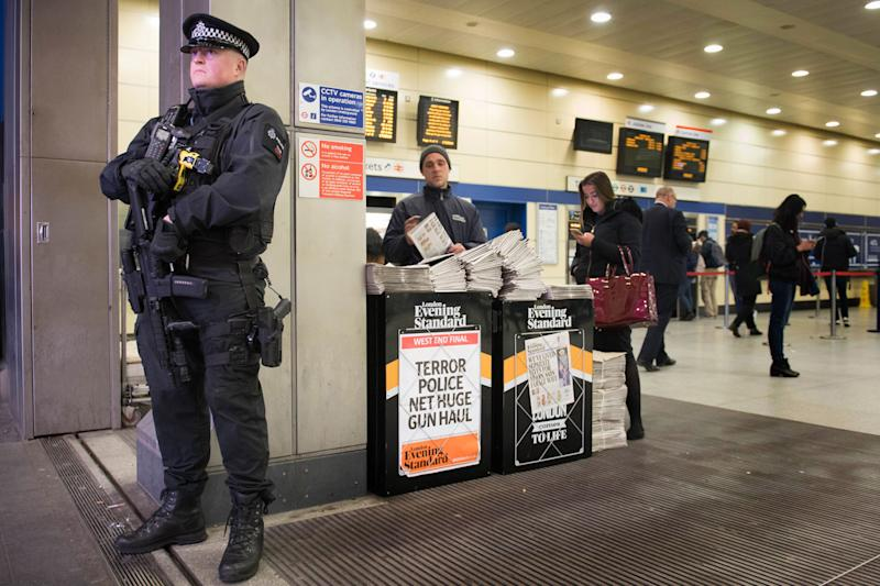 An armed police officer on duty at Stratford Underground station: PA