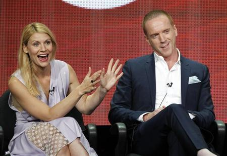 """Claire Danes gestures next to Damian Lewis at a panel for the television series """"Homeland"""" during the Showtime portion of the Television Critics Association Summer press tour in Beverly Hills"""