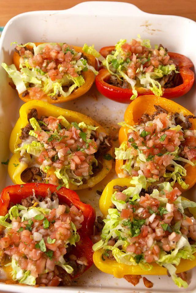 """<p>Taco 'bout a healthy dinner!</p><p>Get the <a href=""""https://www.delish.com/uk/cooking/recipes/a30805720/taco-stuffed-peppers-recipe/"""" rel=""""nofollow noopener"""" target=""""_blank"""" data-ylk=""""slk:Taco Stuffed Peppers"""" class=""""link rapid-noclick-resp"""">Taco Stuffed Peppers</a> recipe. </p>"""