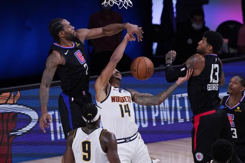 Denver Nuggets guard Gary Harris (14) is blocked by Los Angeles Clippers forward Kawhi Leonard (2) during the second half of an NBA conference semifinal playoff basketball game Tuesday, Sept. 15, 2020, in Lake Buena Vista, Fla. (AP Photo/Mark J. Terrill)