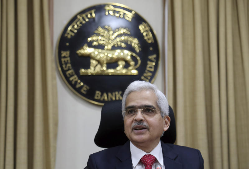 FILE - In this Aug. 7, 2019, file photo, Reserve Bank of India (RBI) Governor Shaktikanta Das speaks during a press conference in Mumbai, India. India's central bank on Friday, May 22, 2020, cut its key interest rate to 4% to revive the economy severely hit the coronavirus outbreak and a two-month lockdown. Reserve Bank of India Governor Das also said India's gross domestic product in financial 2020-21 was expected to have negative growth.  (AP Photo/Rajanish Kakade, File)