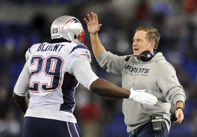New England Patriots head coach Bill Belichick, right, celebrates with running back LeGarrette Blount after Blount scored a touchdown in the second half of an NFL football game against the Baltimore Ravens, Sunday, Dec. 22, 2013, in Baltimore. (AP Photo/Gail Burton)