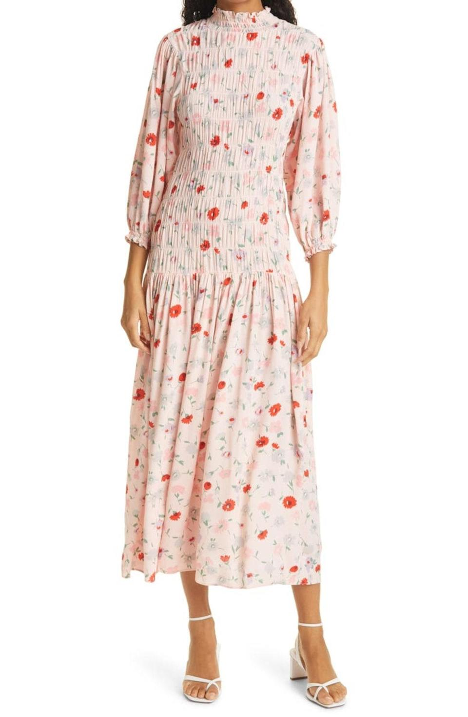"""A printed smocked midi will be a wardrobe MVP this fall. Take cues from the styling and pair with neutral strappy sandals for a no-fail outfit combo. $270, Nordstrom. <a href=""""https://www.nordstrom.com/s/samsoe-samsoe-sarami-floral-long-sleeve-dress/5864600"""" rel=""""nofollow noopener"""" target=""""_blank"""" data-ylk=""""slk:Get it now!"""" class=""""link rapid-noclick-resp"""">Get it now!</a>"""