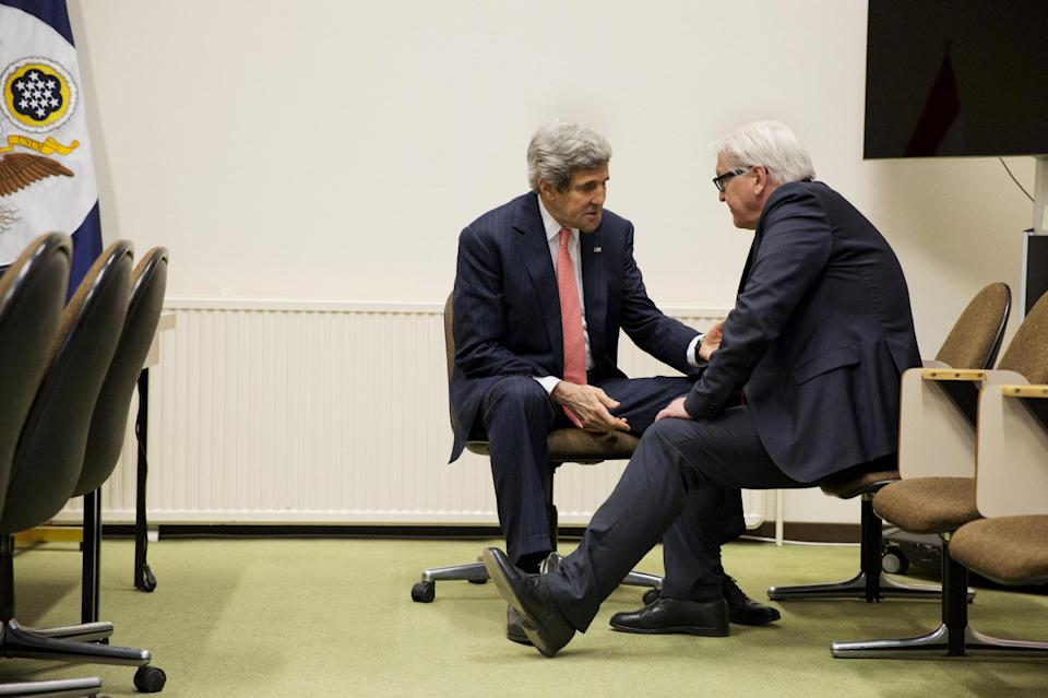 In this April 2, 2014, photo, U.S. Secretary of State John Kerry, left, talks with German Foreign Minister Frank-Walter Steinmeier during a brief meeting at NATO headquarters in Brussels. The current trip was to have been a five-day trip to Europe and Saudi Arabia, but with crisis on multiple fronts and Kerry's decision on how to proceed turned a routine trip abroad into a frenetic tour of high-stakes diplomacy marked by abrupt changes in plan that have come to define his 14-month tenure as secretary of state. (AP Photo/Jacquelyn Martin, Pool)