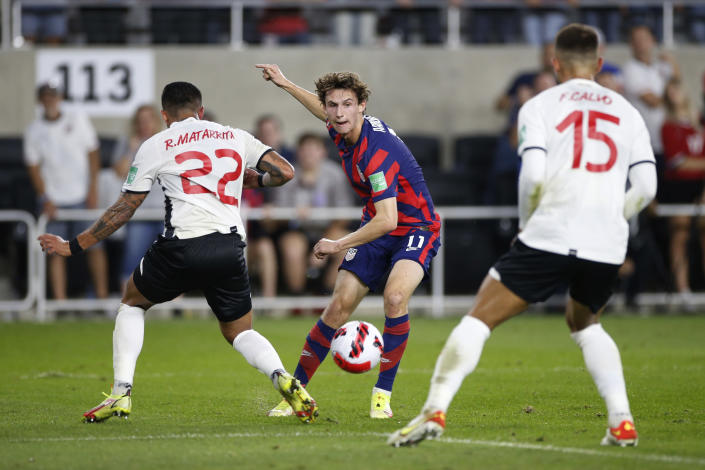 United States' Brenden Aaronson, center, passes the ball between Costa Rica's Ronald Matarrita, left, and Francisco Calvo during the first half of a World Cup qualifying soccer match Wednesday, Oct. 13, 2021, in Columbus, Ohio. (AP Photo/Jay LaPrete)
