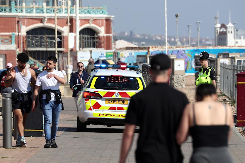 A police car patrols the promenade in Brighton as the UK continues in lockdown to help curb the spread of the coronavirus.as the UK continues in lockdown to help curb the spread of the coronavirus.