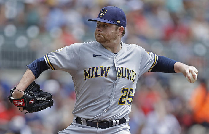 Milwaukee Brewers pitcher Brett Anderson works against the Atlanta Braves during the first inning of a baseball game Sunday, Aug. 1, 2021, in Atlanta. (AP Photo/Ben Margot)