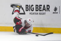 Ottawa Senators center Colin White falls as he tries to pass the puck during the first period of an NHL hockey game against the Los Angeles Kings Wednesday, March 11, 2020, in Los Angeles. (AP Photo/Mark J. Terrill)