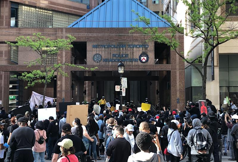 People gathered in front of Toronto police headquarters demanding justice in the death of 29-year-old Regis Korchinski-Paquet. (Photo: Premila D'Sa/HuffPost Canada)
