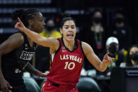 FILE - Las Vegas Aces' Kelsey Plum is shown in action against the Seattle Storm during a WNBA basketball game in Everett, Washington, in this Saturday, May 15, 2021, file photo. Plum is the Sixth Woman of the Year, ending Las Vegas teammate Dearica Hamby's two-year run as the league's top reserve. Plum also earned the Comeback Player of the Year award, announced Wednesday, Sept. 22, 2021.(AP Photo/Elaine Thompson, File)