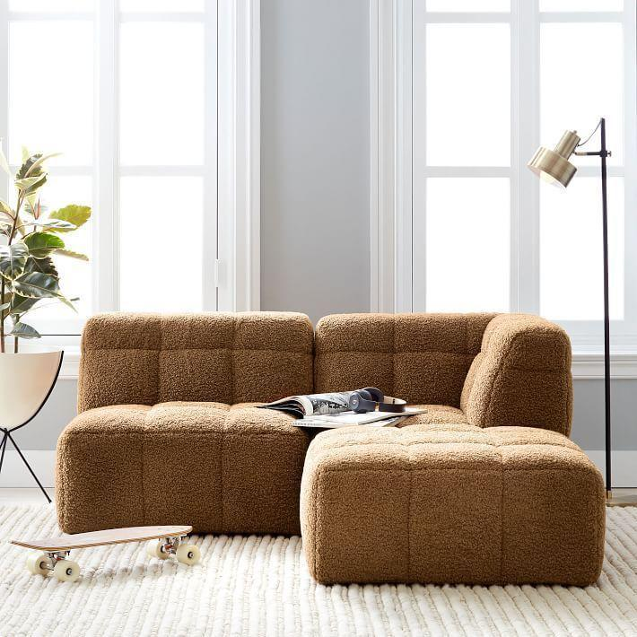 "<p><strong>Pottery Barn Teen</strong></p><p>pbteen.com</p><p><strong>$360.00</strong></p><p><a href=""https://go.redirectingat.com?id=74968X1596630&url=https%3A%2F%2Fwww.pbteen.com%2Fproducts%2Fbaldwin-sectional-set%2F&sref=https%3A%2F%2Fwww.housebeautiful.com%2Fshopping%2Ffurniture%2Fg3816%2Fcozy-couches-and-chairs%2F"" rel=""nofollow noopener"" target=""_blank"" data-ylk=""slk:Shop Now"" class=""link rapid-noclick-resp"">Shop Now</a></p><p>This floor sectional is the ultimate cross between a bean bag and a couch—it gives you the coziness of curling up on a plush seat on the floor but with a little bit of that sofa structure.</p>"