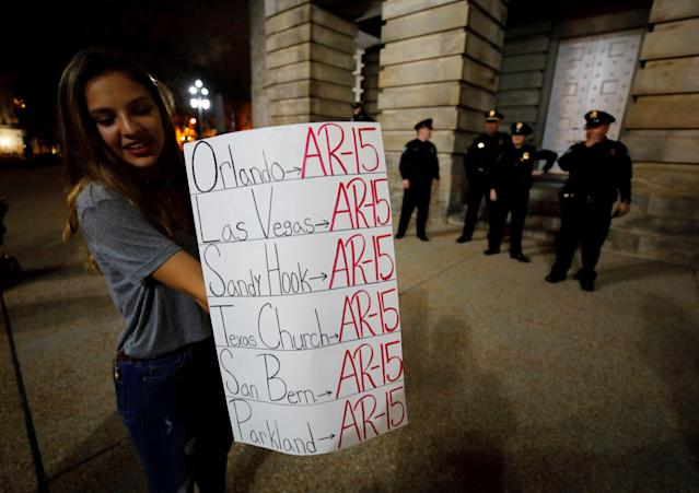 <p>A student holds a sign noting the use of the AR-15 automatic rifle in multiple mass killings, after a demonstration calling for safer gun laws outside the North Carolina State Capitol building six days after the shooting at Marjory Stoneman Douglas High School, in Raleigh, N.C., Feb. 20, 2018. (Photo: Jonathan Drake/Reuters) </p>