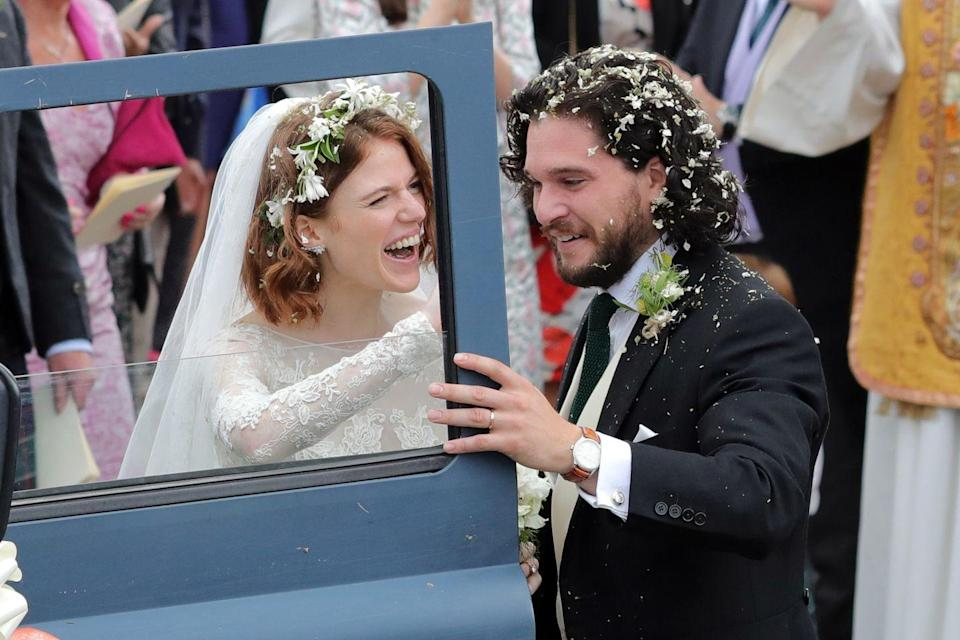 """<p>Game Of Thrones co-stars Rose Leslie and Kit Harington took their on-screen chemistry off-screen. The two sparked dating rumors for years, and technically broke up before their relationship was confirmed, according to <a href=""""https://www.insider.com/game-of-thrones-kit-harington-rose-leslie-jon-snow-ygritte-dating-timeline-2017-7#may-2016-harington-says-in-an-interview-with-vogue-that-he-fell-in-love-while-filming-game-of-thrones-in-iceland-14"""" rel=""""nofollow noopener"""" target=""""_blank"""" data-ylk=""""slk:Business Insider"""" class=""""link rapid-noclick-resp"""">Business Insider</a>. After reports of being back together, Kit revealed he was single in a <a href=""""https://www.gq-magazine.co.uk/article/game-of-thrones-star-kit-harington-on-what-to-expect-in-series-5"""" rel=""""nofollow noopener"""" target=""""_blank"""" data-ylk=""""slk:GQ interview"""" class=""""link rapid-noclick-resp"""">GQ interview</a>. Kit started opening up about Rose after getting back together in 2016.'Because the country is beautiful, because the Northern Lights are magical, and because it was there that I fell in love,' <a href=""""http://www.vogue.it/l-uomo-vogue/cover-story/2016/05/11/kit-harington/"""" rel=""""nofollow noopener"""" target=""""_blank"""" data-ylk=""""slk:he said"""" class=""""link rapid-noclick-resp"""">he said</a>. 'If you're already attracted to someone, and then they play your love interest in the show, it's becomes very easy to fall in love.'</p>"""