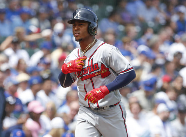 Atlanta Braves' Ozzie Albies rounds the bases after hitting a solo home run off Chicago Cubs' Jose Quintana during the first inning of a baseball game, Monday, May 14, 2018, in Chicago. (AP Photo/Kamil Krzaczynski)