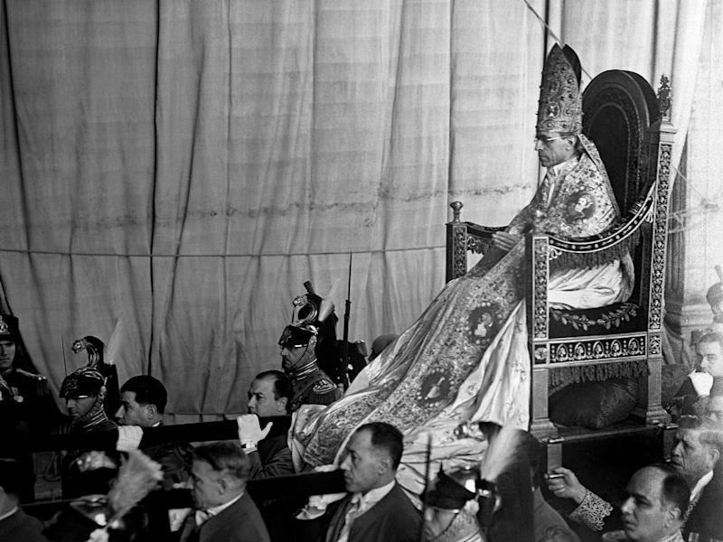 FILE - In this March 12, 1939 file photo, Pope Pius XII is being borne on his portable throne, the Sedia gestatoria, on his way to St. Peter's Basilica at the Vatican. Watching Pope Francis in his first papal appearances, he too doesn't look the type to be carried on a portable throne. After all, he used to take the bus to work as a cardinal back in Buenos Aires, and he eschewed the chauffeur-driven Vatican limousine when he made his first outing, using a simple Vatican car. Change comes slowly, hesitantly and inconsistently at the Vatican. (AP Photo)