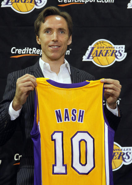 Newly-acquired Los Angeles Lakers guard Steve Nash holds up his new jersey during a news conference at the team's headquarters in El Segundo, Calif., Wednesday, July 11, 2012. The Lakers acquired two-time MVP Nash from the Phoenix Suns in exchange for first round draft picks in 2013 and 2015 as well as second round draft picks in 2013 and 2014. (AP Photo/Reed Saxon)