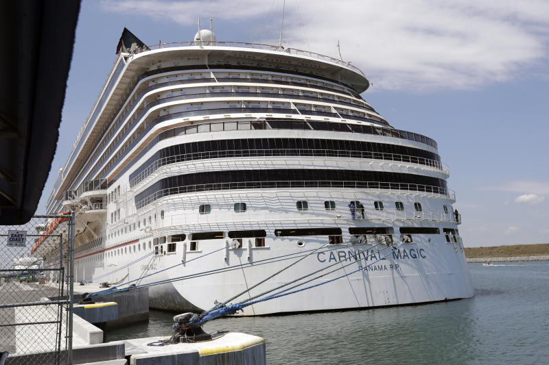 Carnival cruise line ship Carnival Magic is docked at Port Canaveral, Saturday, April 4, 2020, in Cape Canaveral, Fla. (AP Photo/John Raoux)